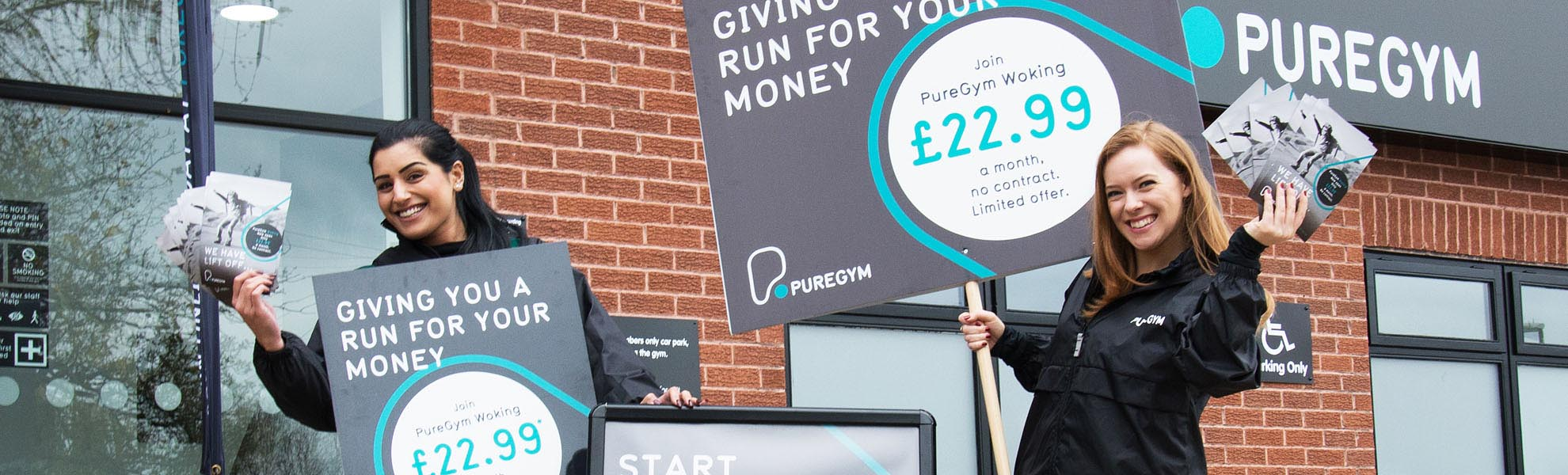 Promotional staff from Zest distribute leaflets for Puregym
